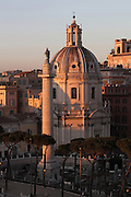 Trajan's Column, completed in 113 AD, probably by Apollodorus of Damascus, with bronze statue of St Peter installed in 1587 by Pope Sixtus V, and dome of the Baroque church of Santissimo Nome di Maria al Foro Traiano (Church of the Most Holy Name of Mary at the Trajan Forum), 1741 by Antoine Derizet, Trajan's Forum, Rome, Italy. Picture by Manuel Cohen