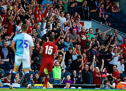 BLACKBURN, ENGLAND - Thursday, July 19, 2018: Liverpool supporters celebrate as Daniel Sturridge scores the second goal during a preseason friendly match between Blackburn Rovers FC and Liverpool FC at Ewood Park. (Pic by David Rawcliffe/Propaganda)