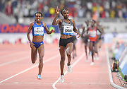 Hellen Obiri (KEN) celebrates after defeating Genzebe Dibaba (ETH) to win the women's 3,000m, 8:25.60 to 8:26.20, during the IAAF Doha Diamond League 2019 at Khalifa International Stadium, Friday, May 3, 2019, in Doha, Qatar