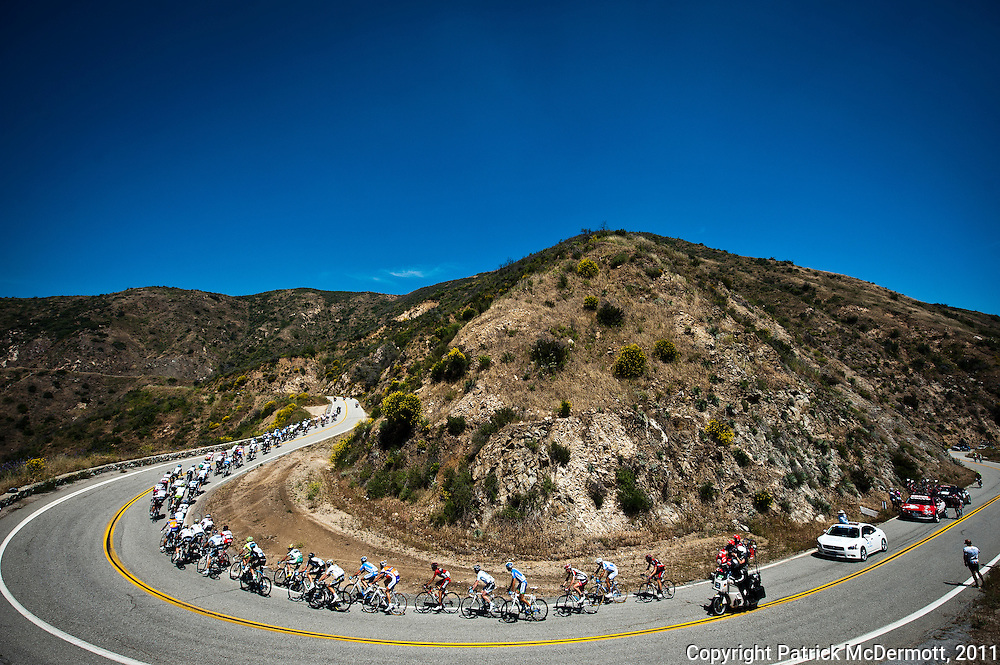 The peloton passes through the Angeles National Forest during stage seven of the 2011 AMGEN Tour of California from Claremont to Mt. Baldy in Los Angeles County, Calif. on Saturday, May 21, 2011.