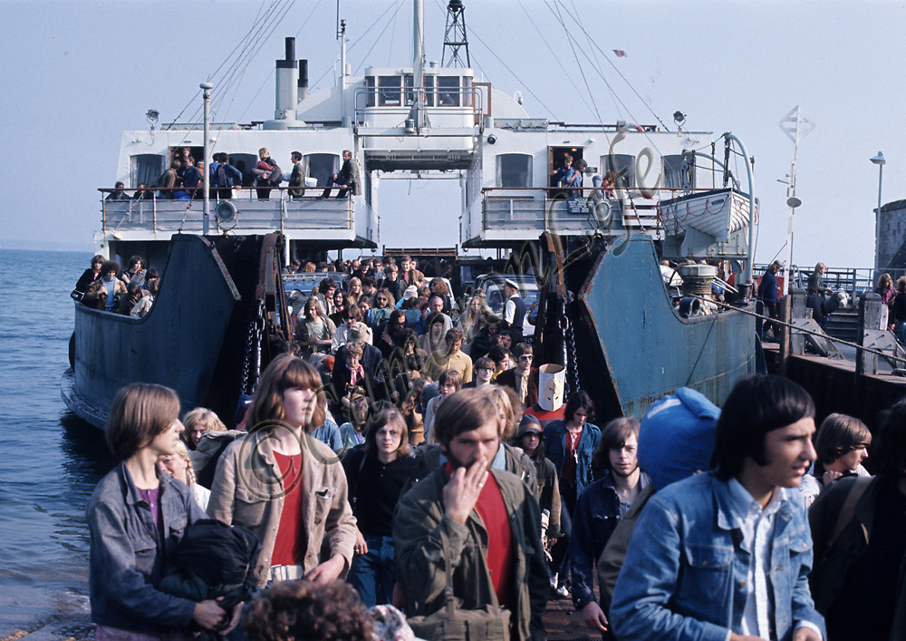 Festival crowd arriving at Yarmouth.- .There had been protests and meetings against this inevitability - but all to no avail - as a reported 600,000 men, women and children descended upon the Isle of Wight in the few days leading up to the festival. Transport services ran to breaking point. MV Farringford is shown disembarking at Yarmouth.