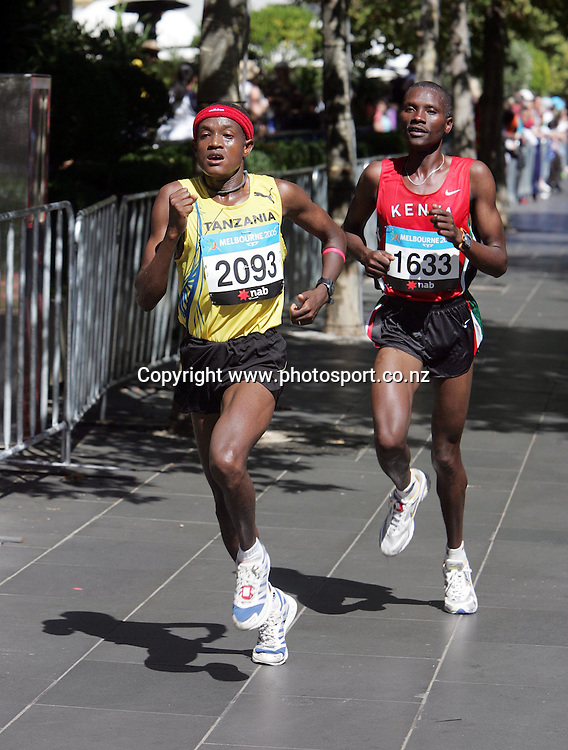 Tanzania's Samson Ramadaninyoni who went on to win gold,leads Kenya's Fred Mogakatumbo,who won silver through the streets of Melbourne in the Mens Marathon during the  at the XV111 Commonwealth Games,Melbourne ,Australia.Saturday, March 19,2006.Photo:Joe Mann/PHOTOSPORT. *** Local Caption *** Womens Marathon