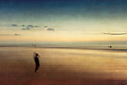 Abstract seascape with a boy in the foreground and others in the back. Textured and manipulated photograph.<br /> <br /> Prints &amp; more: http://society6.com/DirkWuestenhagenImagery/dispersion-of-solitude_Print