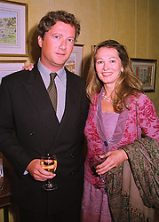 MR & MRS JOHN HEATHER, she was Kimberly DuRoss who's mother is the widow of Henry Ford II, at a party in London on 7th May 1998.MHK 45
