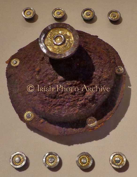 Anglo-Saxon shield fittings, made of iron with silver studs (circa AD 500s). Originally attached to wooden shield board.