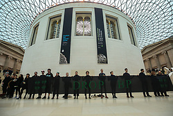 """© Licensed to London News Pictures. 16/02/2019. London, UK. Activities demonstrates inside The British Museum who is sponsoring the current exhibition """"I am Ashurbanipal: king of the world, king of Assyria"""" which is featuring many ancient artefacts from Iraq. By promoting BP, The British Museum is helping a major fossil fuel company and corporate criminal to cleanse its image, make new oil deals and hide its true activities. As the climate crisis unfolds and communities affected by fossil fuel extraction demand justice, it is no longer acceptable for museums and galleries to promote this toxic industry. Photo credit: Dinendra Haria/LNP"""
