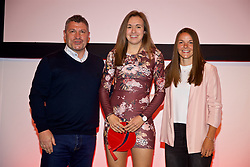 NEWPORT, WALES - Saturday, May 19, 2018: Ellie-Mai Stanford is presented with her Under-16's cap by Osian Roberts (left) and Lauren Dykes (right) during the Football Association of Wales Under-16's Caps Presentation at the Celtic Manor Resort. (Pic by David Rawcliffe/Propaganda)