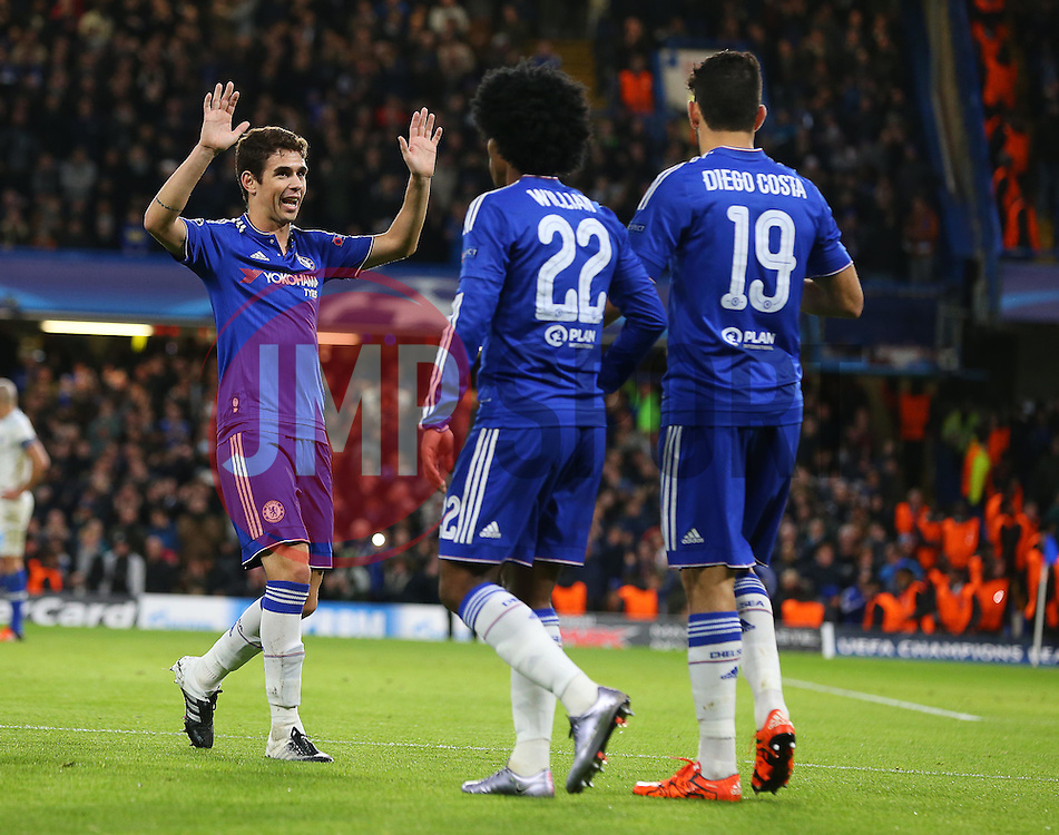 Diego Costa ( R )  of Chelsea celebrates with Oscar ( L ) after Ivan Marcano of FC Porto ( not pictured ) scores an own goal to make it 1-0 - Mandatory byline: Paul Terry/JMP - 09/12/2015 - Football - Stamford Bridge - London, England - Chelsea v FC Porto - Champions League - Group G