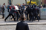 Plauen, Germany -  01.05.2016 <br /> <br /> Neo-Nazis attacking policeman. Hundreds of neo-Nazis participated in a march of the radical right-wing party &acute;Der III. Weg&acute; on the first of May in the Saxon small town Plauen. Because of disputes over the protest route the organizers end their march after a part of the route. Immediately afterwards neo-Nazis try to break through police lines and attack police forces. The police reacts with water cannons, tear gas, pepper spray and batons. After the situation calmed down the police a accepted a following demonstration application back to the starting point.<br /> <br /> Attacke von Neonazis auf Polizisten. Hunderte Neonazi beteiligten sich an einem Aufmarsch der rechtsradikalen Partei III.Weg am 01. Mai im saechsischen Plauen. Wegen Streitigkeiten ueber die Aufzugsroute beendeten die Veranstalter die Demonstration nach einem Teil der Wegstrecke. Unmittelbar darauf versuchten die Rechtsradikalen Polizeikraefte an versuchten Polizeiketten zu durchbrechen. Die Polizei setzte daraufhin Wasserwerfer, Traenengas, Pfefferspray und Schlagstoecke ein. Nachdem sich die Situation beruhigt hatte lie&szlig; die Polizei einer erneute Demonstrationsanmeldung zu - die zurueck zum Startpunkt fuehrte.