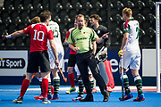 Umpire Lee Barron talks with Holcombe's Iain Lewers. Holcombe v Surbiton - Semi-Final - Men's Hockey League Finals, Lee Valley Hockey & Tennis Centre, London, UK on 22 April 2017. Photo: Simon Parker