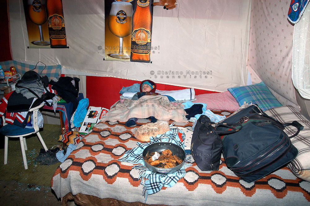Rome  November 1 2007.Vacated Rom's  illegal camp by police in a  area near Tor di Quinto train station inhabited by Romanian Romani  .Here a 47-year-old italian woman, Giovanna Reggiani was killed after an aggression by a Romanian Romani.In a hut, a child sleeps, a plate of food,the suitcases ready for an other trip