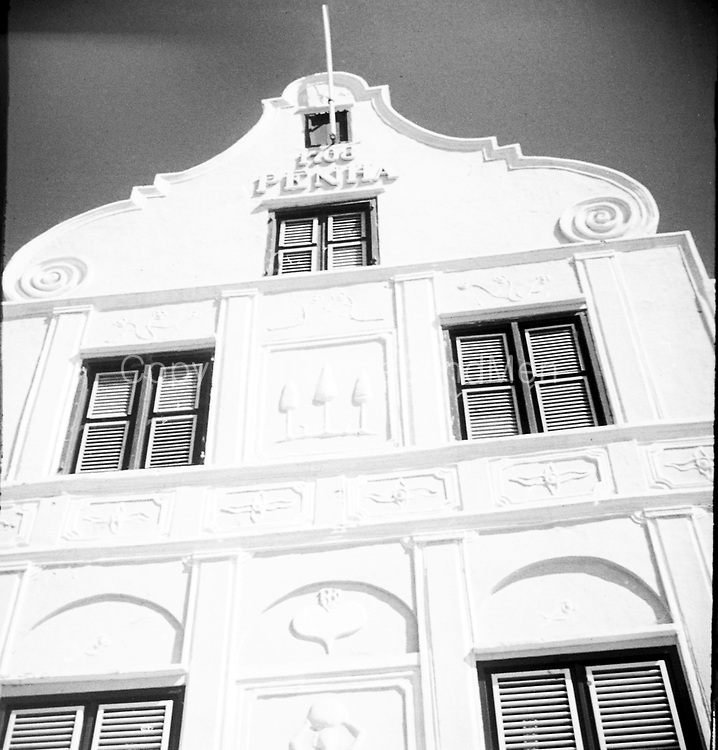 Penha and Sons. Curaçao. <br /> The largest and most populous of the three ABC-islands, Curaçao is also the most architecturally significant. The capital, Willemstad, features beautiful Dutch and Spanish colonial buildings which have helped earn the island its UNESCO World Heritage status. The focal point of these historical buildings is Penha Punda. Built in 1708, it now contains the Penha flagship store, selling top fragrances, cosmetics and apparel.