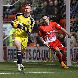 Bristol City's Simon Moore provides a safe pair of hands under pressure from Leyton Orient's Chris Dagnall - Photo mandatory by-line: Robin White/JMP - Tel: Mobile: 07966 386802 11/02/2014 - SPORT - FOOTBALL - Leyton - Brisbane Road - Leyton Orient v Bristol City - Sky Bet League One