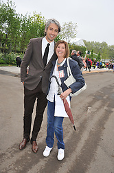 GEORGE LAMB and his mother at the 2013 RHS Chelsea Flower Show held in the grounds of the Royal Hospital, Chelsea on 20th May 2013.