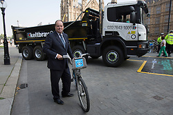 © licensed to London News Pictures. London, UK 04/09/2013. Transport Minister Stephen Hammond attending to a photocall to unveil plans to tackle HGV blind spots to improve cycle safety in London on Tuesday, September 4, 2013. Photo credit: Tolga Akmen/LNP