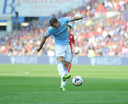 Manchester City's Edin Dzeko strikes the ball in the box and scores. - Photo mandatory by-line: Alex James/JMP - Tel: Mobile: 07966 386802 25/08/2013 - SPORT - FOOTBALL - Cardiff City Stadium - Cardiff -  Cardiff City V Manchester City - Barclays Premier League