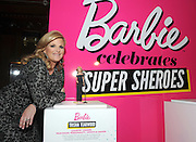 "Trisha Yearwood poses with her one-of-a-kind Barbie at the Variety Power of Women event, Friday, April 24, 2015, in New York, where she was honored as a Barbie ""Shero.""  Trisha, along with Ava DuVernay, Emmy Rossum, Eva Chen, Kristin Chenoweth and Sydney ""Mayhem"" Keiser, are the first ever Barbie Sheroes, which celebrates women who are inspiring girls.  (Photo by Diane Bondareff/Invision for Barbie/AP Images)"
