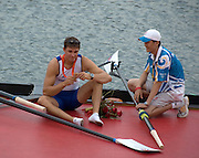Shunyi, CHINA. GBR M4- Peter REED sits, and looks at his gold medal and chats with the boat holder,  after the medal ceremony,  Olympic Regatta, Shunyi Rowing Course.  Sunday  17/08/2008  [Mandatory Credit:  Svend Aage Nielsen/  Intersport Images]