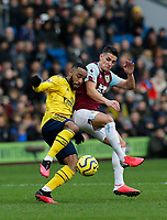 Football - 2019 / 2020 Premier League - Burnley vs. Arsenal<br /> <br /> Ashley Westwood of Burnley holds off Alexandre Lacazette of Arsenal, at Turf Moor.<br /> <br /> <br /> COLORSPORT/ALAN MARTIN
