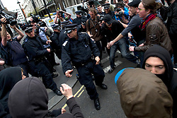 © London News Pictures. 11/06/2013. London, UK. Scuffles break out in the streets surrounding a squat at abandoned police station on Beak Street, London which is being used by Anti-G8 activists as their headquarters ahead of a demonstration in central London today (Tues) The G8 Summit is due to take place in Norther Ireland early next week. Photo credit: Ben Cawthra/LNP