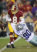 Dallas Cowboys defensive end Demarcus Lawrence (90) sacks Washington Redskins quarterback Kirk Cousins (8) on the third play of the first quarter causing a fumble and setting the tone for a defensive struggle during the 2015 week 13 regular season NFL football game against the Washington Redskins on Monday, Dec. 7, 2015 in Landover, Md. The Cowboys won the game 19-16. (©Paul Anthony Spinelli)