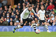 Fulham Striker, Ross McCormack (44) driving forward during the Sky Bet Championship match between Fulham and Cardiff City at Craven Cottage, London, England on 9 April 2016. Photo by Matthew Redman.