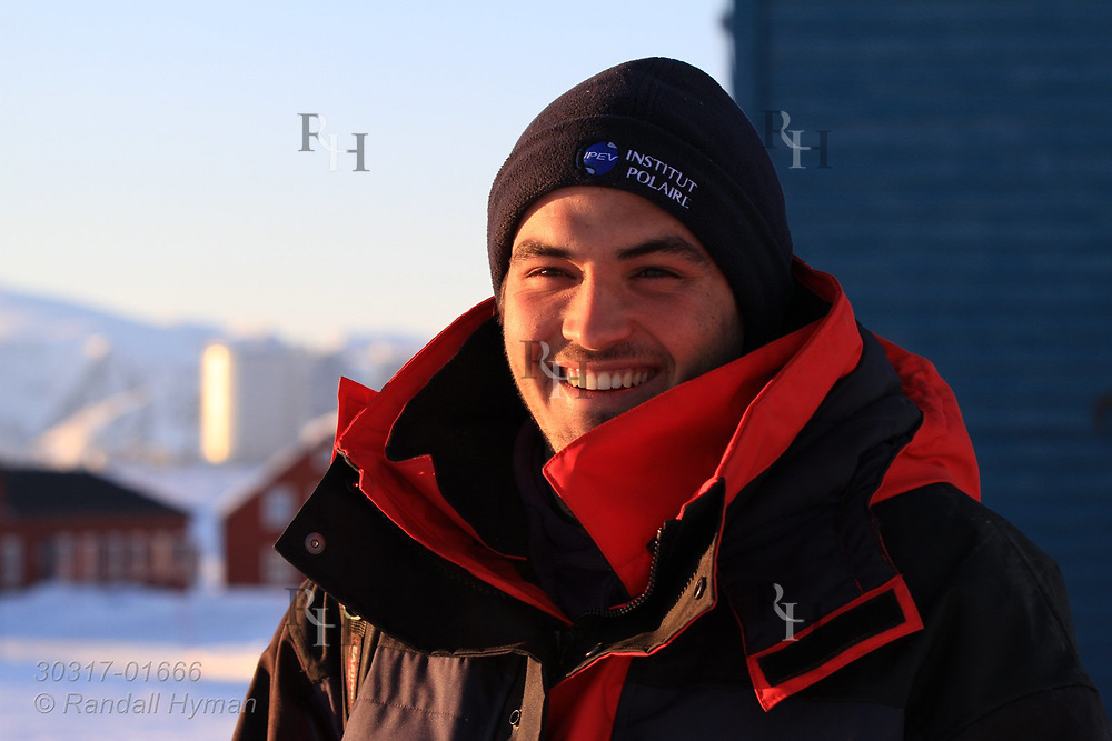 Portrait of scientist in winter gear at the international science village of Ny-Alesund on Spitsbergen island in Kongsfjorden; Svalbard, Norway.