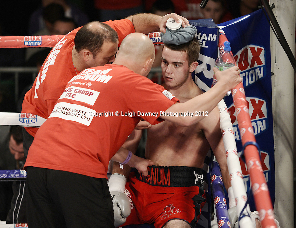 John Dignum (red/black shorts) defeats Joe Walsh in a Middleweight contest at York Hall, Bethnal Green, London on the 1st Novemeber 2012. Frank Warren Promotions. © Leigh Dawney Photography 2012.