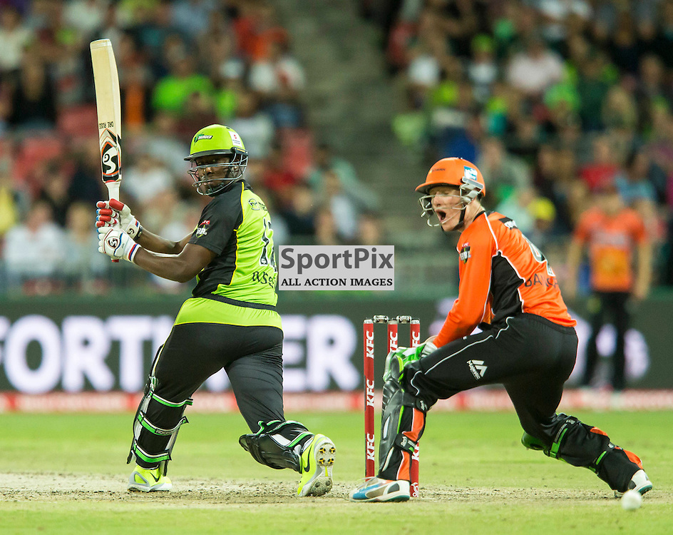 KFC Big Bash League T20 2015-16 , Sydney Thunder v Perth Scorchers, Spotless Stadium; 7 January 2016<br /> Sydney Thunder Andre Russell swings and misses a ball that goes ver his stumps.