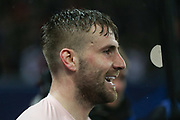 Manchester United Defender Luke Shaw celebrates during the Champions League Round of 16 2nd leg match between Paris Saint-Germain and Manchester United at Parc des Princes, Paris, France on 6 March 2019.