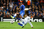 Picture by Daniel Chesterton/Focus Images Ltd +44 7966 018899<br /> 18/09/2013<br /> Mohamed Salah of FC Basel tackles Ashley Cole of Chelsea during the UEFA Champions League match at Stamford Bridge, London.