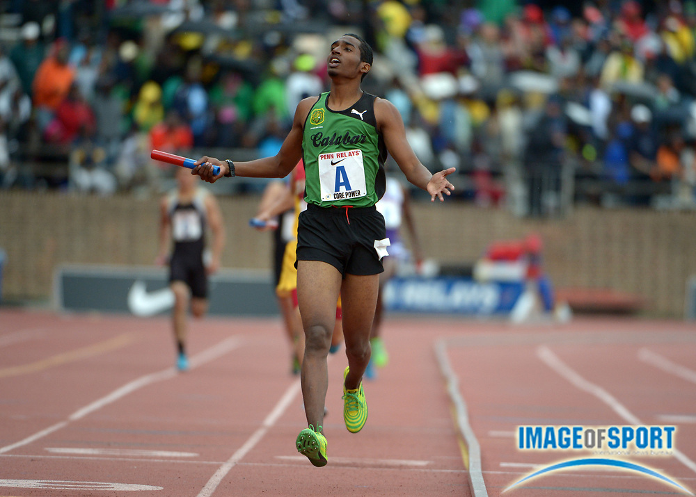 Apr 26, 2014; Philadelphia, PA, USA; Jorel Bellafonte celebrates after running the anchor leg on the Calabar 4 x 800m relay that won the Championship of America race in 7:37.36 in the 120th Penn Relays at Franklin Field.