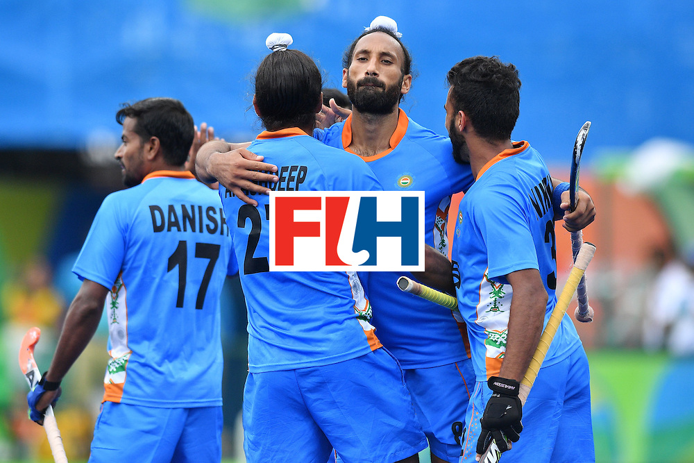 India's Akashdeep Singh celebrates scoring a goal with his teammates during the mens's field hockey India vs Canada match of the Rio 2016 Olympics Games at the Olympic Hockey Centre in Rio de Janeiro on August, 12 2016. / AFP / Carl DE SOUZA        (Photo credit should read CARL DE SOUZA/AFP/Getty Images)