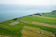 Nederland, Noord-Holland, Gemeente Zeevang, 05-08-2014; IJsselmeerdijk of Zeevangs Keukendijk, Markermeer. Strokenverkaveling van het land in Polder Zeevang, gelegen tussen Edam en Hoorn <br /> Seawall and polder north of Amsterdam<br /> luchtfoto (toeslag op standard tarieven);<br /> aerial photo (additional fee required);<br /> copyright foto/photo Siebe Swart