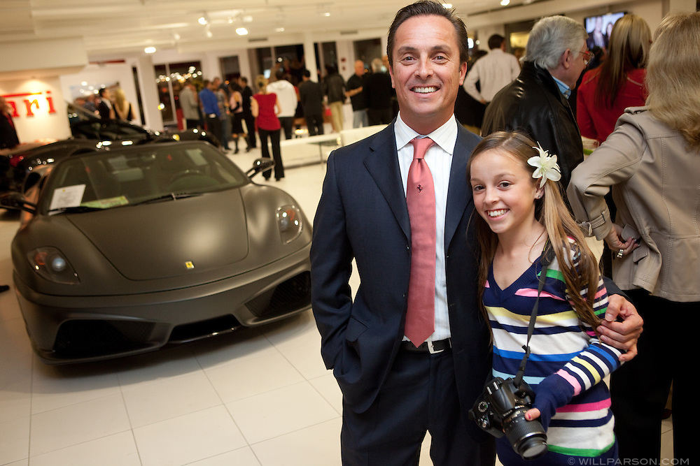 Ronald Giger, general manager of Ferrari and Maserati of San Diego, with his daughter Madison Giger.