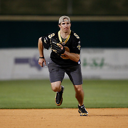 Apr 28, 2010; Metairie, LA, USA; Drew Brees (9) runs for a ground ball during the Heath Evans Foundation charity softball featuring teammates of the Super Bowl XLIV Champion New Orleans Saints at Zephyrs Field.  Mandatory Credit: Derick E. Hingle-US-PRESSWIRE.