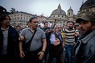 Roma, 12 Maggio 2014<br /> Manifestazione dei Movimenti per il diritto all'abitare hanno contestato il Presidente del Consiglio Matteo Renzi che parlava sul palco di piazza del Popolo per la manifestazione conclusiva del Partito Democratico in vista delle elezioni europee di domenica. Attivisti dei Movimenti per la Casa sono stati fermati dalla Polizia. Nella foto: un manifestante del Partito Democratico, colpisce un attivista dei Movimenti per la Casa <br /> Rome, May 12, 2014 <br /> Manifestation of the movements for housing rights, objected to the Chairman of the Board, Matteo Renzi, who spoke on stage at the Piazza del Popolo to the closing event of the Democratic Party in the European elections on Sunday. Activists of the Movement for the House were stopped by the police. In the photo: a demonstrator of the Democratic Party, strikes an activist of the Movements for the Home