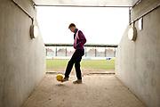 Teenager Kicking Football