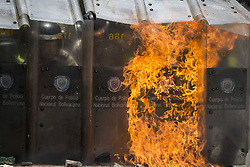 May 4, 2017 - Caracas, Venezuela - Riot police protect themselves with their shields after students at the Central University of Venezuela thrown molotov cocktails at them during a protest against the government of Nicolas Maduro in Caracas on May 4, 2017. (Credit Image: © Panoramic via ZUMA Press)