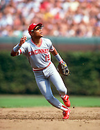 CHICAGO-CIRCA 1990: Barry Larkin of the Cincinnati Reds fields against the Chicago Cubs during an MLB game at Wrigley Field in Chicago, Illinois.  Larkin played for the Reds from 1986-2004.   (Photo by Ron Vesely)   Subject: Barry Larkin.
