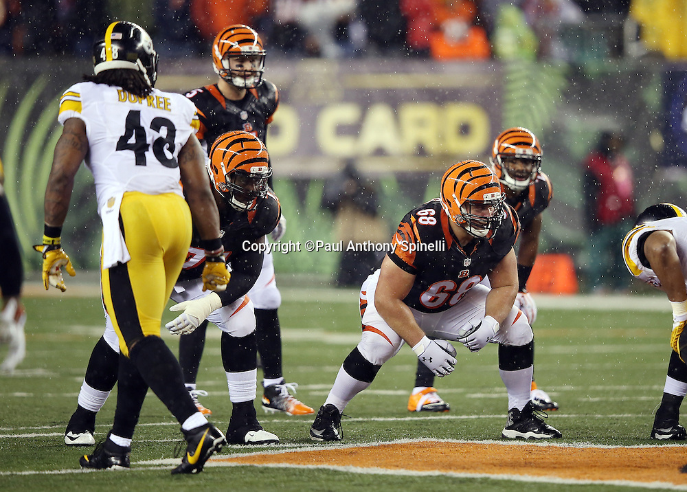 Cincinnati Bengals guard Kevin Zeitler (68) gets set in a two point stance at the line of scrimmage as Pittsburgh Steelers rookie outside linebacker Bud Dupree (48) gets set to rush during the NFL AFC Wild Card playoff football game against the Pittsburgh Steelers on Saturday, Jan. 9, 2016 in Cincinnati. The Steelers won the game 18-16. (©Paul Anthony Spinelli)