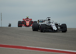 October 20, 2018 - Austin, USA - Williams Martini Racing driver Lance Stroll (18) of Canada rounds the hill at Turn 10 with Scuderia Ferrari driver Kimi Raikkonen (7) of Finland following during qualifying at the Formula 1 U.S. Grand Prix at the Circuit of the Americas in Austin, Texas on Saturday, Oct. 20, 2018. (Credit Image: © Scott Coleman/ZUMA Wire)