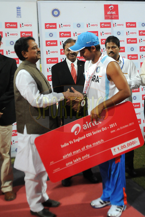 Suresh Raina of India receives the AIRTEL man of the match award during the 4th One Day International ( ODI ) match between India and England held at the Wankhede Stadium, Mumbai on the 23rd October 2011..Photo by Pal Pillai/BCCI/SPORTZPICS