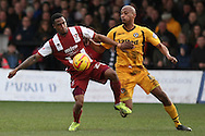 Craig Braham-Barrett of Cheltenham Town and Chris Zebroski of Newport County (r) . Skybet football league 2 match, Newport county v Cheltenham Town at Rodney Parade in Newport, South Wales on Saturday 22nd Feb 2014.<br /> pic by Mark Hawkins, Andrew Orchard sports photography.