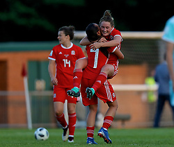 NEWPORT, WALES - Tuesday, June 12, 2018: Wales' Natasha Harding (left) and Rachel Rowe (right) celebrate at the final whistle after beating Russia 3-0 during the FIFA Women's World Cup 2019 Qualifying Round Group 1 match between Wales and Russia at Newport Stadium. (Pic by David Rawcliffe/Propaganda)