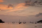 Boats in the shore at sunset . Portobelo, Caribbean, Colon province, Panama, Central America.