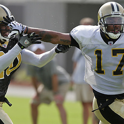 31 July 2009:  New Orleans Saints wide receiver Robert Meachem (17) stiff arms cornerback Randall Gay (20) during a drill during the opening day of New Orleans Saints training camp held at the team's practice facility in Metairie, Louisiana.