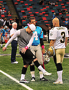 "New Orleans Saints kicker John Carney, recently resigned, is seen giving instructions to New Orleans kicker Garrett Hartley while the Carolina Panthers kicker John Kasey watches nad gives advice prior to the Saints -v-Panthers game Sunday Oct. 3,2010. Carney went on to kick three feild goals to help the saints win while Hartley did not play at all. The NFL has gone ""Pink"" for October in honor of Breast Cancer Awareness. The Saints went on to win 16-14. John Carney kicked three field goals to help the Saints win. PHOTO©SuziAltman.com"