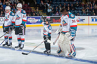 KELOWNA, CANADA - DECEMBER 27: The Pepsi Save On Foods Player of the Game lines up with Rodney Southam #17, Nolan Foote #29 and Michael Herringer #30 of the Kelowna Rockets against the Kamloops Blazers on December 27, 2016 at Prospera Place in Kelowna, British Columbia, Canada.  (Photo by Marissa Baecker/Shoot the Breeze)  *** Local Caption ***