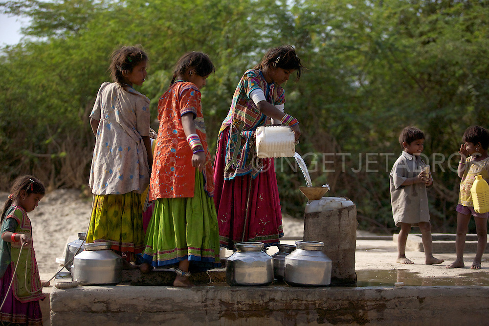Children collecting water in a remote area in Gujarat,India,2012<br /> http://ingetjetadros.photoshelter.com/gallery/Wulla-Podu-The-Sacred-Month/G0000QR_ngPAnQrg/C0000In7R8U.FAjw